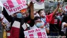 Demonstrators march against presidential candidate Pedro Castillo in Lima, Peru, Saturday, May 29, 2021. Just days out from a June 6 presidential election run-off, protestors are rallying a demonstration against the Free Peru party candidate at what they cite as the dangerous leftist policies he represents. (AP Photo/Martin Mejia)