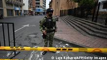 A Colombian soldier stands guard in a street the day after protests against the Colombian President Ivan Duque's government, in Cali, Colombia, on May 29, 2021. - The Colombian army on Saturday tightened its control over Cali, the country's third largest city, after the latest anti-government protests left at least 13 people dead. (Photo by Luis ROBAYO / AFP) (Photo by LUIS ROBAYO/AFP via Getty Images)