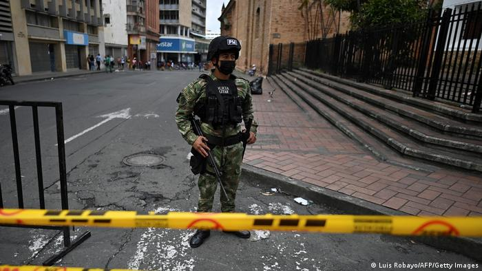 A single Colombian solider stands guard in Cali