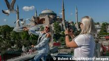 A Ukranian tourist Alena poses for a picture near the Hagia Sophia Mosque at Sultanahmet in Istanbul on May 9, 2021, during a new lockdown aimed at fighting a surging third wave of Covid-19 infections. - Turkey welcomes foreign tourists while locking down locals from April 29 to May 17. (Photo by BULENT KILIC / AFP) (Photo by BULENT KILIC/AFP via Getty Images)