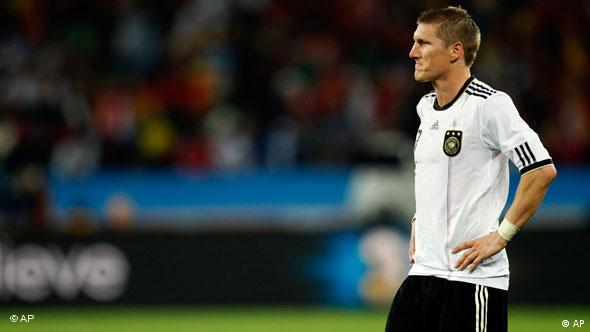 Germany's Bastian Schweinsteiger reacts after Spain's Carles Puyol, not visible, scored a goal.