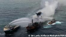 Smoke rises from a fire onboard the MV X-Press Pearl vessel in the seas off the Colombo Harbour, in Sri Lanka May 30, 2021. Sri Lanka Airforce Media/Handout via REUTERS ATTENTION EDITORS - THIS IMAGE HAS BEEN SUPPLIED BY A THIRD PARTY. MANDATORY CREDIT. NO RESALES. NO ARCHIVES. TPX IMAGES OF THE DAY