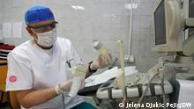 A medical professional prepares an ultrasound examination of the breast in the Clinical Center in Nis, 30.05.2021.