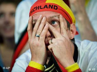 A Germany fan looking through his fingers
