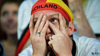 German fan in despair after losing to Spain