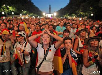 German fans react watching the World Cup soccer match between Germany and Spain at a public viewing area in Berlin