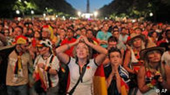Germany fans at public viewing in Berlin react as Germany lose to Spain in the World Cup semifinal