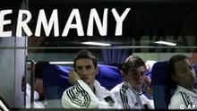 From left, Germany's Miroslav Klose, Germany's Toni Kroos and Germany's Dennis Aogo sit in the team bus after the World Cup semifinal soccer match between Germany and Spain at the Moses Mabhida stadium in Durban, South Africa, Wednesday July 7, 2010. Spain won 1-0. (AP Photo/Gero Breloer)