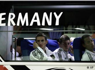 Miroslav Klose and other players on the team bus looking defeated
