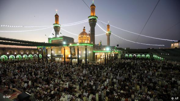 Shiite pilgrims gather at the Imam Moussa al-Kadhim shrine for the annual commemoration of the saint's death, in the Shiite district of Kazimiyah, in Baghdad, Iraq, Wednesday, July 7, 2010. Militants struck across the Iraqi capital Wednesday, killing scores of people, including 32 in a suicide bombing that targeted pilgrims commemorating a revered Shiite saint, Iraqi police said. (AP Photo/Karim Kadim)