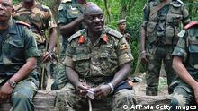 Chief of Defence Forces of Uganda (UPDF) General Edward Katumba Wamala (C) sits with chief of general staff of the Armed Forces of the Democratic Republic of Congo (FARDC) Lieutenant General Didier Etumba Longila (L) and FARDC commander General Leon Mushale (R) in Beni in North Kivu on May 7, 2014. Katumba and Etumba are visiting troops taking part in an ongoing military operation against Allied Democratic Forces (ADF) rebels in the area. AFP PHOTO/STRINGER (Photo credit should read STRINGER/AFP via Getty Images)