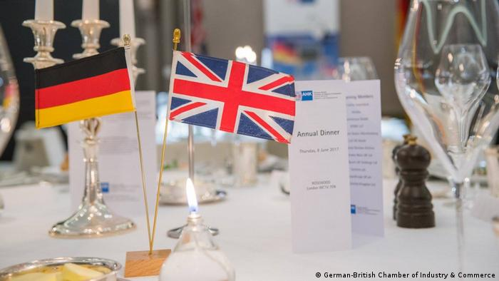 German and British flags on a table