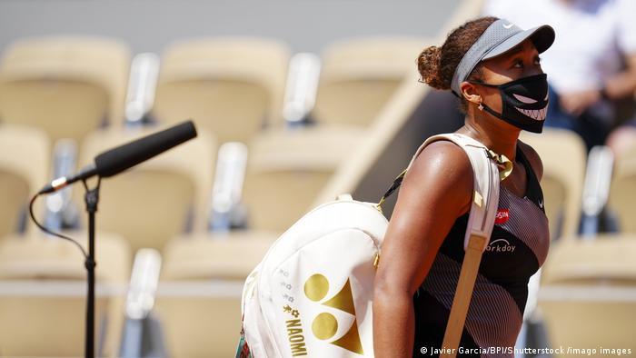 Naomi Osaka walks away from the microphone at the 2021 French Open
