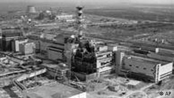 This 1986 aerial view of the Chernobyl nuclear plant in Chernobyl, Ukraine shows damage from an explosion and fire in reactor four on April 26, 1986 that sent large amounts of radioactive material into the atmosphere. Ten years after the world's worst nuclear accident, the plant is still running due to a severe shortage of energy in Ukraine. (AP Photo/ Volodymyr Repik)