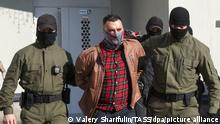MINSK, BELARUS - SEPTEMBER 15, 2020: Law enforcement officers escort detained local resident Stepan Latypov from a building at Change Square in Chervyakova Street. Latypov has been detained while trying to interfere with law enforcement officers painting over a mural depicting DJs Vlad Sokolovsky and Kirill Galanov. Sokolovsky and Galanov put on Peremen [Changes], a song by Russian singer Viktor Tsoi, during an event organized by the Belarusian authorities on August 6. The DJs were arrested, spent 10 days in prison and left the country. Utility workers paint over the mural but local residents restore it. Valery Sharifulin/TASS