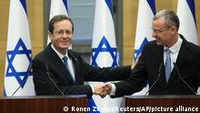 Presidential candidate Isaac Herzog shakes hands with Yariv Levin, Speaker of the Knesset, during a special session of the Knesset, whereby Israeli lawmakers elect a new president, at the plenum in the Knesset, Israel's parliament, in Jerusalem on Wednesday, June 2, 2021. (Ronen Zvulun/Pool Photo via AP)
