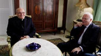 Cuba's Cardinal Jaime Ortega, left, sits with Spain's Foreign Minister Miguel Angel Moratinos