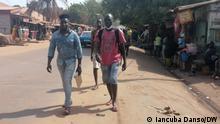 Menschen auf der Straße in Bissau, Guinea Bissau Copyright: Iancuba Danso/DW 2.6.2021