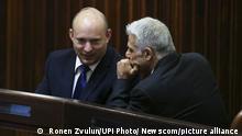 02.06.2021***Yamina party leader Naftali Bennett (L) smiles as he speaks to Yesh Atid party leader Yair Lapid during a special session of the Knesset where Israeli lawmakers elected Isaac Herzog as the new president in Jerusalem on Wednesday, June 2, 2021. Yair Labid hopes to form a new government to replace Netanyahu as Prime Minister later today. Pool Photo by Ronen Zvulun/UPI Photo via Newscom picture alliance