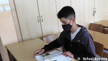Pupil Manuel Miskovic In classroom reading and prepearinf for exam