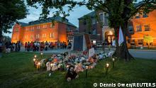 Kamloops residents and First Nations people gather to listen to drummers and singers at a memorial in front of the former Kamloops Indian Residential School after the remains of 215 children, some as young as three years old, were found at the site last week, in Kamloops, British Columbia, Canada May 31, 2021. REUTERS/Dennis Owen