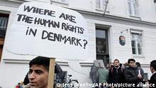 FILE PHOTO 26.09.2021***Some thirty Syrian refugees from different camps seeking asylum hold banners outside the Swedish Embassy in Copenhagen, Denmark on Wednesday, Sept. 26, 2012. The Syrians claim that Danes won't give them asylum because Denmark doesn't consider the civil war in Syria to affect all parts of Syria. Sweden gives a three-year temporary asylum to Syrians what ever part of Syria they come from. (AP Photo/POLFOTO/Jens Dresling) DENMARK OUT