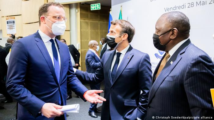 German health minister Jens Spahn, French president Emmanuel Macron and South African President Cyril Ramaphosa