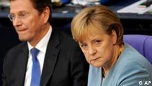 Bundeskanzlerin Angela Merkel, CDU und Aussenminister Guido Westerwelle, FDP, aufgenommen am Freitag, 9. Juli 2010, im Bundestag in Berlin. (apn Photo/Berthold Stadler) --- German chancellor Angela Merkel, CDU, and German foreign minister Guido Westerwelle, FDP, seen at the German parliament Bundestag in Berlin on Friday, July 9, 2010. (apn Photo/Berthold Stadler)