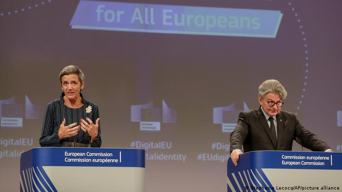 Margrethe Vestager, left, and European Commissioner for Internal Market Thierry Breton participate in a media conference at EU headquarters in Brussels,