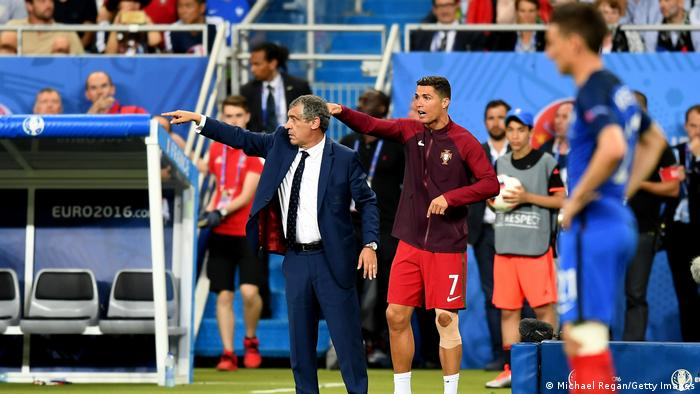 Ronaldo and coach Fernando Santos gesture on the touchline during the Euro 2016 Final match between Portugal and France