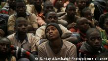 FILE - In this Dec. 18, 2020 file photo, some of the schoolboys who were kidnapped from the all-boys Government Science Secondary School in Katsina state sit together following their release in Katsina, Nigeria. Schools in northern Nigeria are on high alert after the kidnappings at the Salihu Tanko Islamic School in Niger state on Sunday, May 31, 2021 marked the latest in a long spate of violent abductions carried out for ransom this year by unknown attackers in the north. (AP Photo/Sunday Alamba, File)