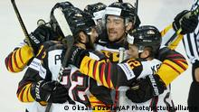 Players of Germany team celebrate a goal during the Ice Hockey World Championship quaterfinal match between Switzerland and Germany at the Olympic Sports Center in Riga, Latvia, Thursday, June 3, 2021. (AP Photo/Oksana Dzadan)