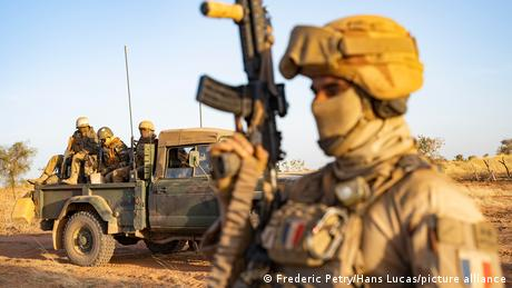 French and Malian troops in a pickup truck, seen in January 2021