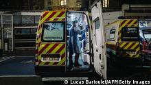 A French first aid worker from the Protection Civile Paris Seine, disinfects an ambulance after it was used to ferry a patient suspected of being infected with COVID-19, as Paris and the rest of the nation experiences a coronavirus outbreak on April 3, 2020. - France has been on lockdown since March 17 in a bid to limit the contagion caused by the novel coronavirus, a situation it has extended until at least April 15. (Photo by Lucas BARIOULET / AFP) (Photo by LUCAS BARIOULET/AFP via Getty Images)