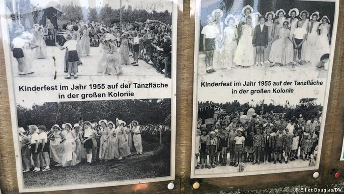 An information board shows the community at the garden in the past