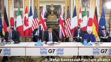 Britain's Chancellor of the Exchequer Rishi Sunak, centre, at a meeting of finance ministers from across the G7 nations at Lancaster House in London, Friday June 4, 2021. (Stefan Rousseau/Pool via AP)