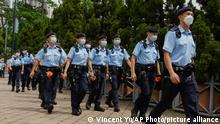 Police officers march at Hong Kong Victoria Park, Friday, June 4, 2021. Police arrested an organizer of Hong Kong's annual candlelight vigil remembering the deadly Tiananmen Square crackdown and warned people not to attend the banned event Friday as authorities mute China's last pro-democracy voices. In past years, tens of thousands of people gathered in Hong Kong's Victoria Park to honor the victims who died when China's military put down student-led pro-democracy protests on June 4, 1989, killing hundreds if not thousands. (AP Photo/Vincent Yu)