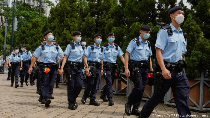 Police officers march on Victoria Park in Hong Kong