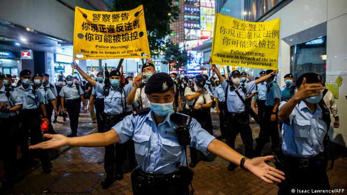 Police move to disperse Hong Kong residents gathering in the Causeway Bay district of Hong Kong.