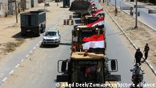 June 4, 2021, Rafah, Gaza Strip, Palestinian Territory: A convoy of bulldozers, excavators and trucks loaded with construction equipment provided by Egypt arrives at the Palestinian side of the Rafah border crossing between Egypt and the Palestinian Gaza Strip enclave on June 4, 2021. - Egypt sent an aid convoy to neighbouring Gaza with diggers, trucks and cranes to ''prepare the ground for reconstruction'' of the Palestinian enclave following a ceasefire between its Islamist rulers Hamas and Israel that brought an end to 11 days of deadly fighting. Egypt's heavily secured Rafah crossing is the Gaza Strip's only passage to the outside world not controlled by Israel. Sisi has pledged $500 million to help reconstruction efforts in densely populated Gaza, home to some two million people (Credit Image: © Abed Deeb/APA Images via ZUMA Wire