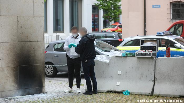 Police investigators stand outside the synagogue in Ulm