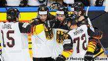 Germany's Matthias Plachta, 3rd right, celebrates with teammates after scoring his side's opening goal during the Ice Hockey World Championship semifinal match between Finland and Germany at the Arena in Riga, Latvia, Saturday, June 5, 2021. (AP Photo/Sergei Grits)