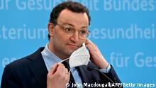 German Health Minister Jens Spahn takes his protective face mask off to address a press conference on the situation of the coronavirus (Covid-19) pandemic, on February 8, 2021 in Berlin. (Photo by John MACDOUGALL / AFP) (Photo by JOHN MACDOUGALL/AFP via Getty Images)