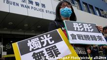 Chow Hang Tung, Vice Chairperson of the Hong Kong Alliance in Support of the Democratic Patriotic Movements of China, holds placards after being released on bail at a police station in Hong Kong, Saturday, June 5, 2021. Hong Kong police on Friday, June 4, arrested Chow for publicizing an unauthorized assembly via social media despite the police ban on the annual June 4 candlelight vigil. The placards read: Innocent of candlelight, Tung Tung will return from victory. (AP Photo/Kin Cheung)