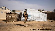 (FILES) In this file photograph taken on February 3, 2020, a Burkina Faso soldier patrols at a camp sheltering Internally Displaced People (IDP) from northern Burkina Faso in Dori. - Suspected jihadists have massacred at least 114 civilians in Burkina Faso's volatile north in the deadliest attacks since Islamist violence erupted in the west African country in 2015, officials said June 5, 2021. (Photo by OLYMPIA DE MAISMONT / AFP)