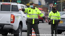 10/02/2021*** A member of the Colombian Police Department stops a vehicle on the street to control it in Bogota, Colombia, on February 10, 2021. - On February 9, 2021, Cuba alerted Colombia about a plan by the ELN guerrilla to attack Bogota in the next few days, according to a message released by the government of Ivan Duque on Monday. (Photo by Raul ARBOLEDA / AFP) (Photo by RAUL ARBOLEDA/AFP via Getty Images)
