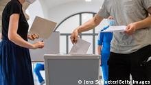 MAGDEBURG, GERMANY - JUNE 06: Voters cast their ballots in Saxony-Anhalt state elections on June 6, 2021 in Wittenberg, Germany. Polls show the election is a tight race between the German Christian Democrats (CDU) and the far-right Alternative for Germany (AfD). Many see the outcome of the election as a barometer for German federal elections scheduled for September. The current Saxony-Anhalt state government is a coalition between the CDU, German Social Democrats (SPD) and the German Greens party. (Photo by Jens Schlueter/Getty Images)