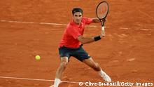 PARIS, FRANCE - JUNE 05: Roger Federer of Switzerland plays a backhand during his Men's Singles third round match against Dominik Koepfer of Germany on day seven of the 2021 French Open at Roland Garros on June 05, 2021 in Paris, France. (Photo by Clive Brunskill/Getty Images)
