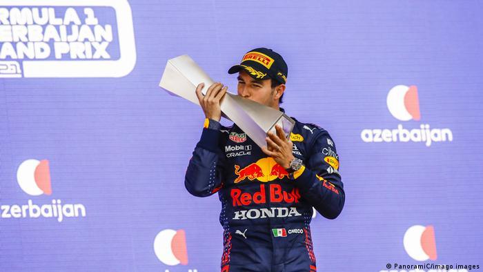 Sergio Perez celebrates his first Grand Prix win for Red Bull
