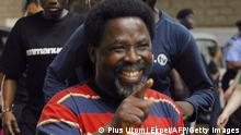 Founder of the Synagogue Church of All Nations (SCOAN) tele-evangelist T.B.Joshua gestures during the President of Nigeria's visit to the church at Ikotun in Lagos on September 20, 2014. Nigerian President Goodluck Jonathan visited the collapsed guesthouse at a mega-church in the economic capital of Lagos on September 20, vowing to investigate the cause of the tragedy which left at least 86 dead. AFP PHOTO/PIUS UTOMI EKPEI (Photo credit should read PIUS UTOMI EKPEI/AFP via Getty Images)